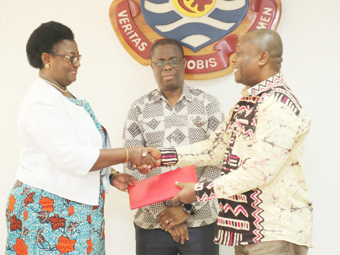New Pro Vice-Chancellor, Prof. Dora Edu-Buandoh receiving the handing over notes from Prof. George K. T. Oduro